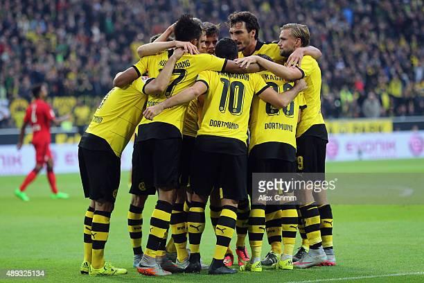 Shinji Kagawa of Dortmund celebrates his team's second goal with team mates during the Bundesliga match between Borussia Dortmund and Bayer...
