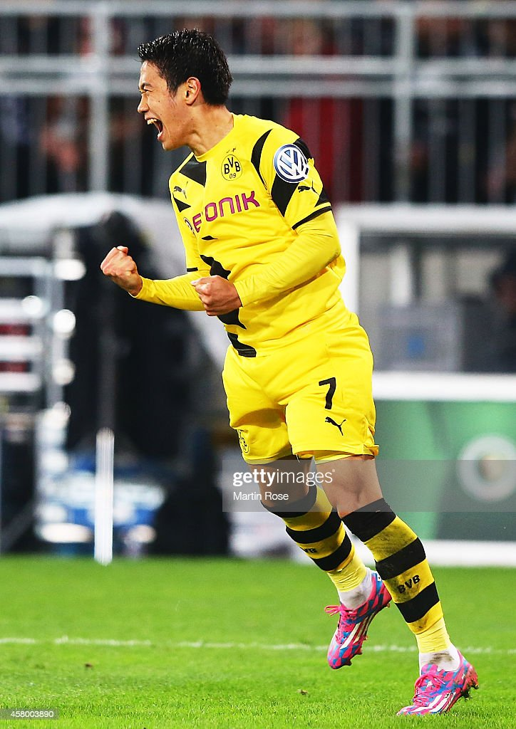 Shinji Kagawa of Dortmund celebrates scoring a goal during the DFB Cup match between FC St Pauli and Borussia Dortmund at Millerntor Stadium on...