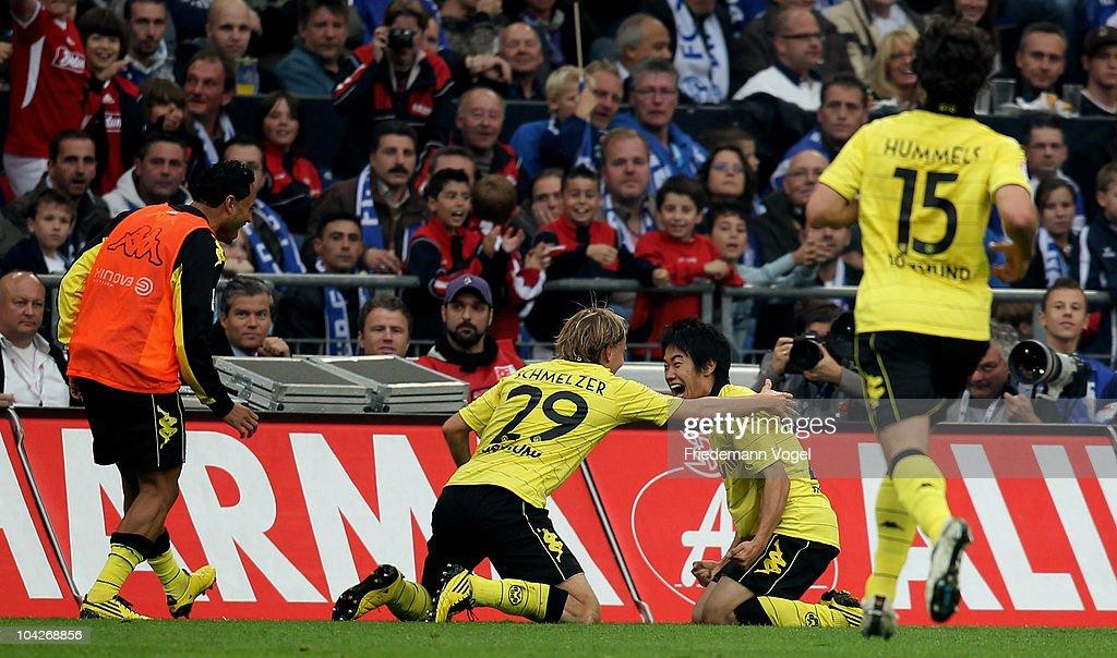 Shinji Kagawa of Dortmund celebrates scoring the first goal during the Bundesliga match between FC Schalke 04 and Borussia Dortmund at Veltins Arena...