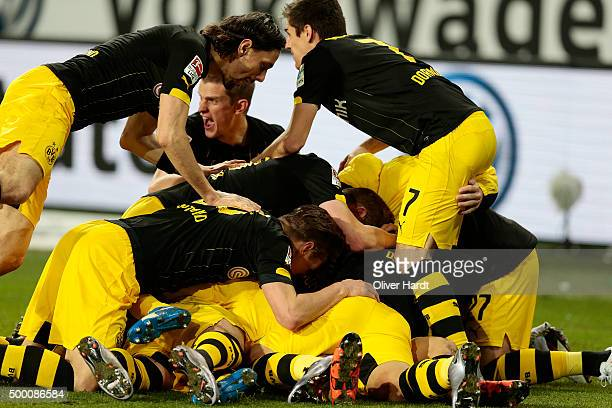 Shinji Kagawa of Dortmund celebrates scoring the second goal with his team mates during the First Bundesliga match at between VfL Wolfsburg and...