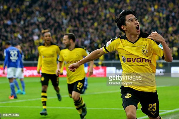 Shinji Kagawa of Dortmund celebrates the first goal during the Bundesliga match between Borussia Dortmund and FC Schalke 04 at Signal Iduna Park on...