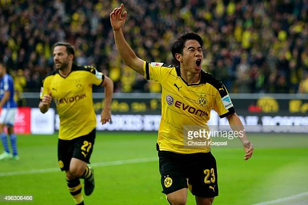 Shinji Kagawa of Dortmund celebrates the first goal during the Bundesliga match between Borussia Dortmund and FC Schalke 04 at Signal Iduna Park on...