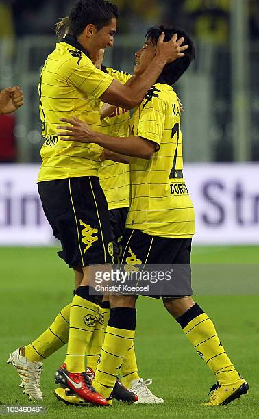 Shinji Kagawa of Dortmund celebrates the first goal with Nuri Sahin during the UEFA Europa League PlayOff match between Borussia Dortmund and Qarabag...