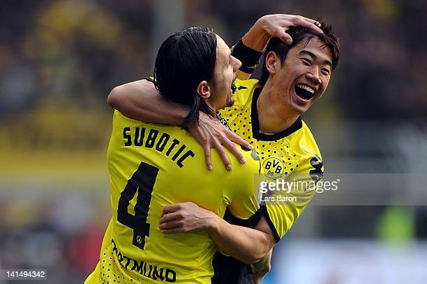 Shinji Kagawa of Dortmund celebrates with team mate Neven Subotic after scoring his teams first goal during the Bundesliga match between Borussia...