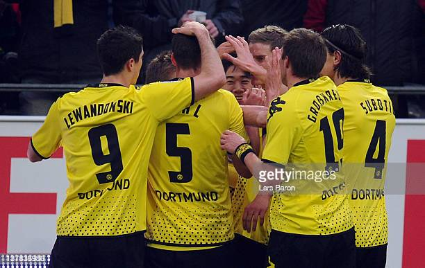 Shinji Kagawa of Dortmund celebrates with team mates after scoring his teams first goal during the Bundesliga match between Borussia Dortmund and...