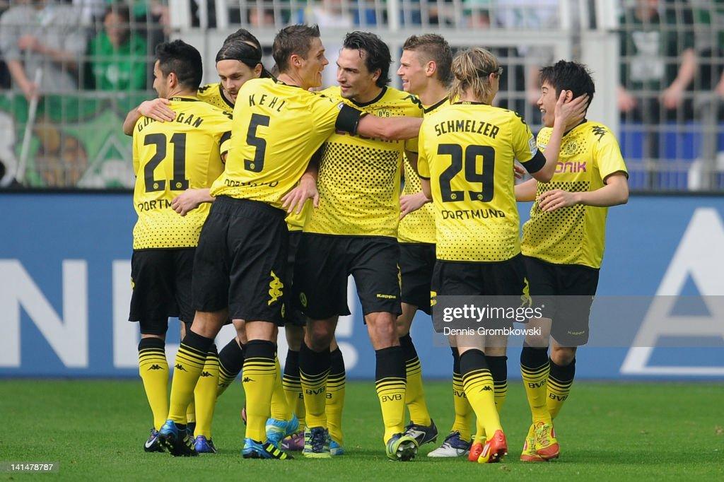 Shinji Kagawa of Dortmund celebrates with teammates after scoring his team's opening goal during the Bundesliga match between Borussia Dortmund and...