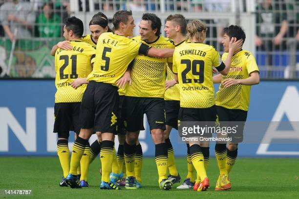 Shinji Kagawa of Dortmund celebrates with teammates after scoring his team's opening goal during the Bundesliga match between Borussia Dortmund and...