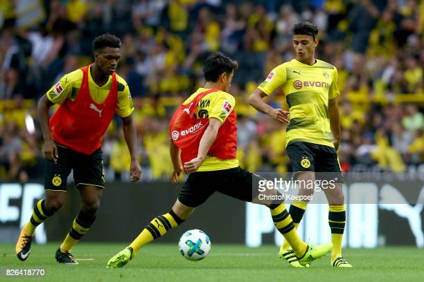 Shinji Kagawa of Dortmund challenges Mahmoud Dahoud of Dortmund during the Borussia Dortmund Season Opening 2017/18 at Signal Iduna Park on August 4...