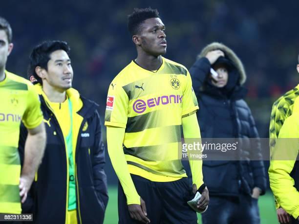 Shinji Kagawa of Dortmund DanAxel Zagadou of Dortmund and Jeremy Toljan of Dortmund looks dejected during the Bundesliga match between Borussia...