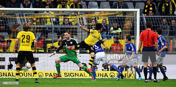 Shinji Kagawa of Dortmund heads his teams first goal during the Bundesliga match between Borussia Dortmund and FC Schalke 04 at Signal Iduna Park on...