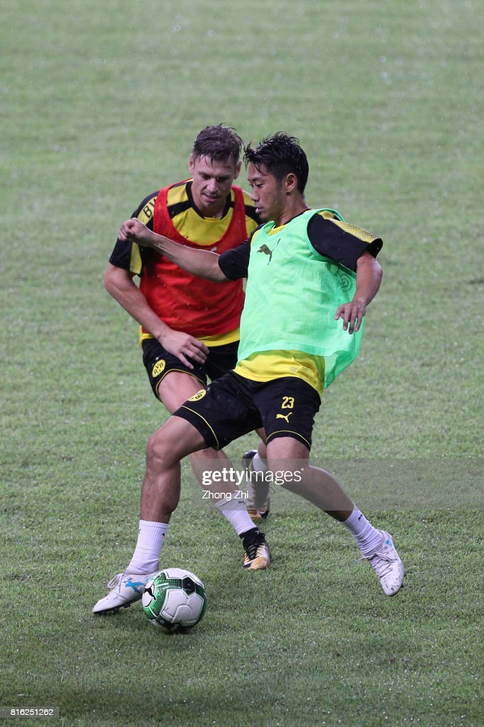 Shinji Kagawa of Dortmund(R) in action duirng training session ahead of the 2017 International Champions Cup football match between AC Milan and Borussia Dortmund at University Town Sports Centre Stadium on July 17, 2017 in Guangzhou, China.