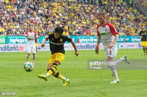 Shinji Kagawa of Dortmund in action during the Bundesliga match between FC Augsburg and Borussia Dortmund at WWKArena on September 30 2017 in...