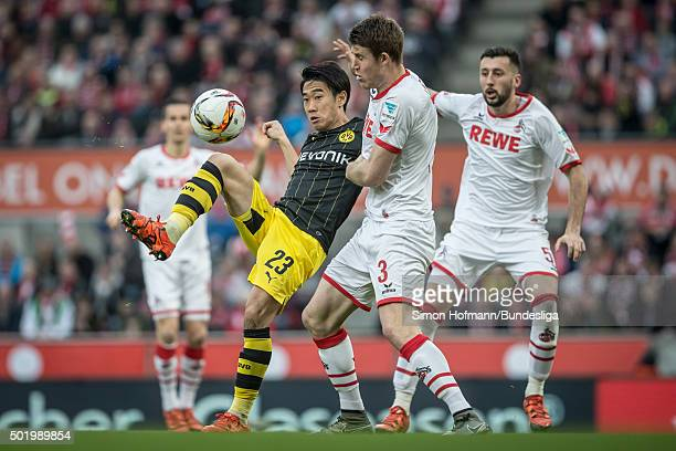 Shinji Kagawa of Dortmund is challenged by Dominique Heintz of Koeln during the Bundesliga match between 1 FC Koeln and Borussia Dortmund at...