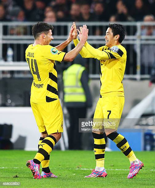 Shinji Kagawa of Dortmund is congratulated by Milos Jojic after scoring a goal during the DFB Cup match between FC St Pauli and Borussia Dortmund at...