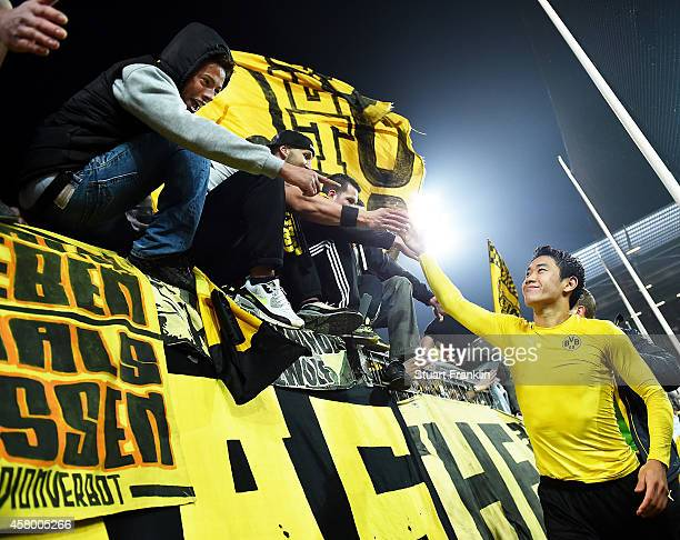Shinji Kagawa of Dortmund is congratulated by the fans after the DFB Cup match between FC St Pauli and Borussia Dortmund at Millerntor Stadium on...