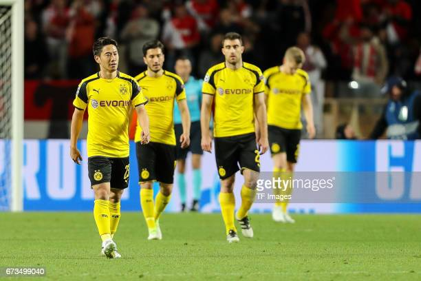 Shinji Kagawa of Dortmund Nuri Sahin of Dortmund Sokratis of Dortmund looks dejected during the UEFA Champions League quarter final second leg match...