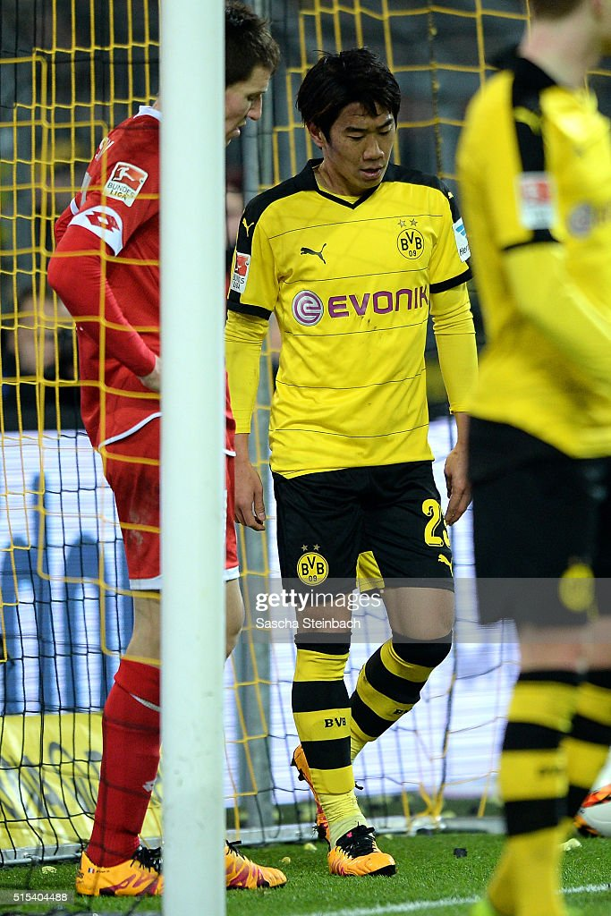 Shinji Kagawa of Dortmund reacts after scoring his team's second goal during the Bundesliga match between Borussia Dortmund and 1. FSV Mainz 05 at Signal Iduna Park on March 13, 2016 in Dortmund, Germany.