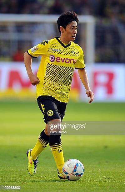 Shinji Kagawa of Dortmund runs with the ball during the Bundesliga match between Borussia Dortmund and 1 FC Koeln at Signal Iduna Park on October 22...