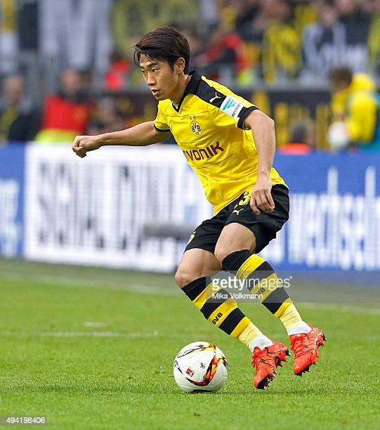 Shinji Kagawa of Dortmund runs with the ball during the Bundesliga match between Borussia Dortmund and FC Augsburg at Signal Iduna Park on October 25...