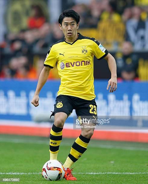 Shinji Kagawa of Dortmund runs with the ball during the Bundesliga match between Borussia Dortmund and FC Schalke 04 at Signal Iduna Park on November...