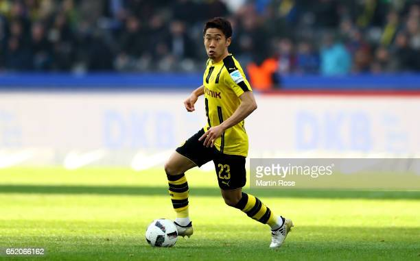 Shinji Kagawa of Dortmund runs with the ball during the Bundesliga match between Hertha BSC and Borussia Dortmund at Olympiastadion on March 11 2017...