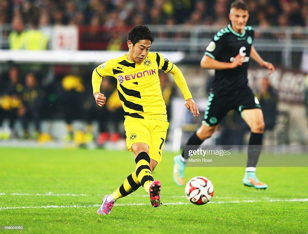 Shinji Kagawa of Dortmund scores a goal during the DFB Cup match between FC St Pauli and Borussia Dortmund at Millerntor Stadium on October 28 2014...