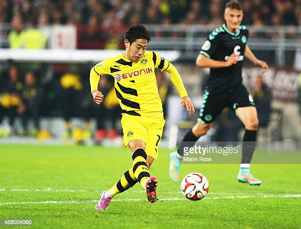 Shinji Kagawa of Dortmund scores a goal during the DFB Cup match between FC St Pauli and Borussia Dortmund at Millerntor Stadium on October 28 2014...