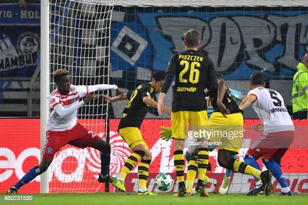 Shinji Kagawa of Dortmund scores his teams first goal to make it 10 during the Bundesliga match between Hamburger SV and Borussia Dortmund at...
