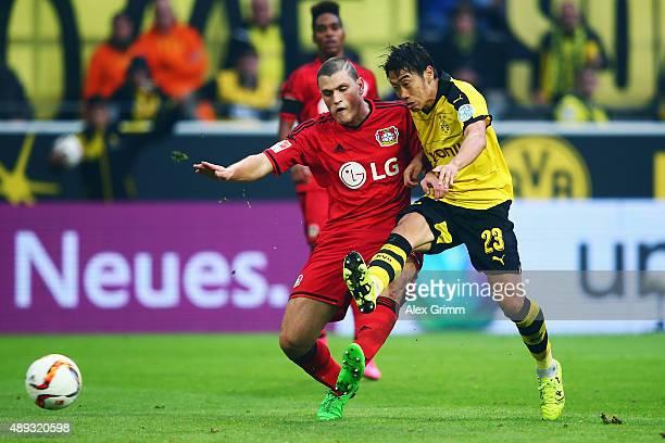 Shinji Kagawa of Dortmund scores his team's second goal against Kyriakos Papadopoulos of Leverkusen during the Bundesliga match between Borussia...