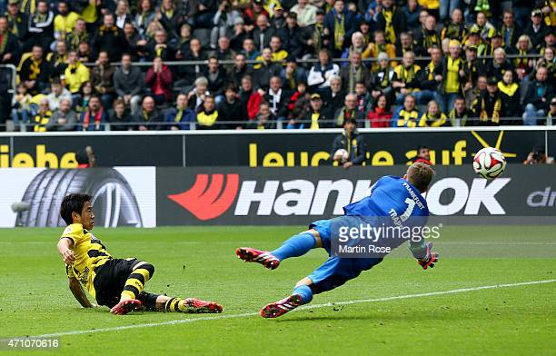 Shinji Kagawa of Dortmund scores the 2nd goal during the Bundesliga match between Borussia Dortmund and Eintracht Frankfurt at Signal Iduna Park on...