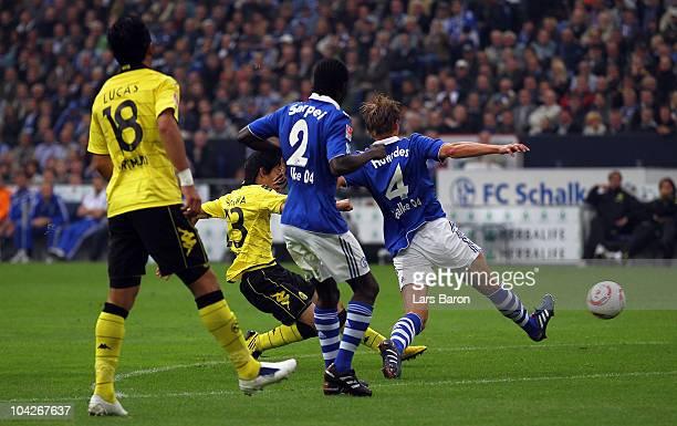 Shinji Kagawa of Dortmund scores the first goal during the Bundesliga match between FC Schalke 04 and Borussia Dortmund at Veltins Arena on September...