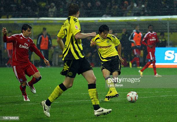 Shinji Kagawa of Dortmund scores the first goal during the Bundesliga match between Borussia Dortmund and Hamburger SV at Signal Iduna Park on...