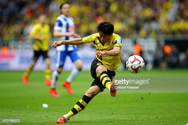 Shinji Kagawa of Dortmund shoost the ball during the Bundesliga match between Borussia Dortmund and Hertha BSC Bwerlin at Signal Iduna Park on May 9...