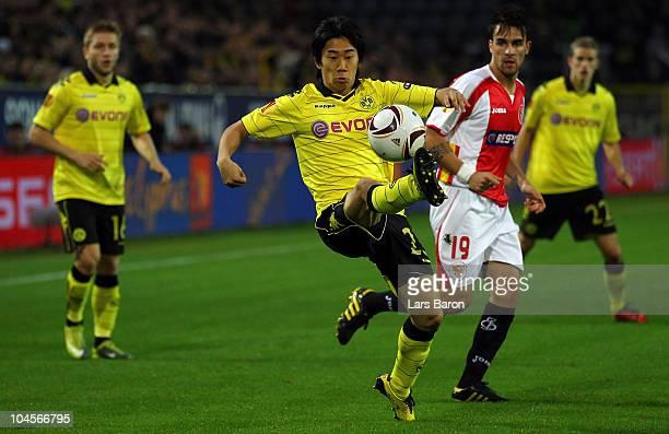 Shinji Kagawa of Dortmund stopps the ball next to Luca Cigarini of Sevilla during the UEFA Europa League group J match between Borussia Dortmund and...