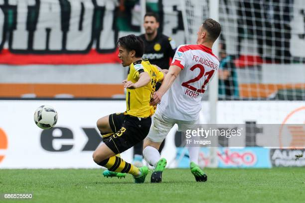 Shinji Kagawa of Dortmund und Dominik Kohr of Augsburg battle for the ball during the Bundesliga match between FC Augsburg and Borussia Dortmund at...