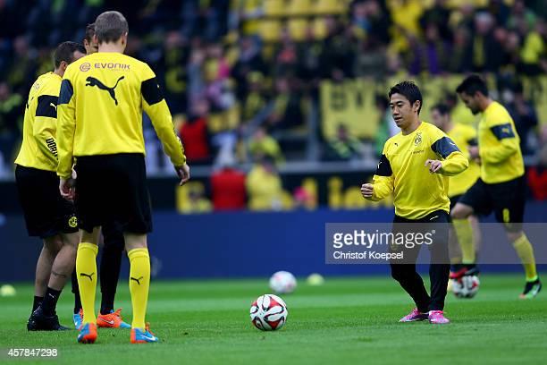 Shinji Kagawa of Dortmund wamrs up prior to the Bundesliga match between Borussia Dortmund and Hannover 96 at Signal Iduna Park on October 25 2014 in...