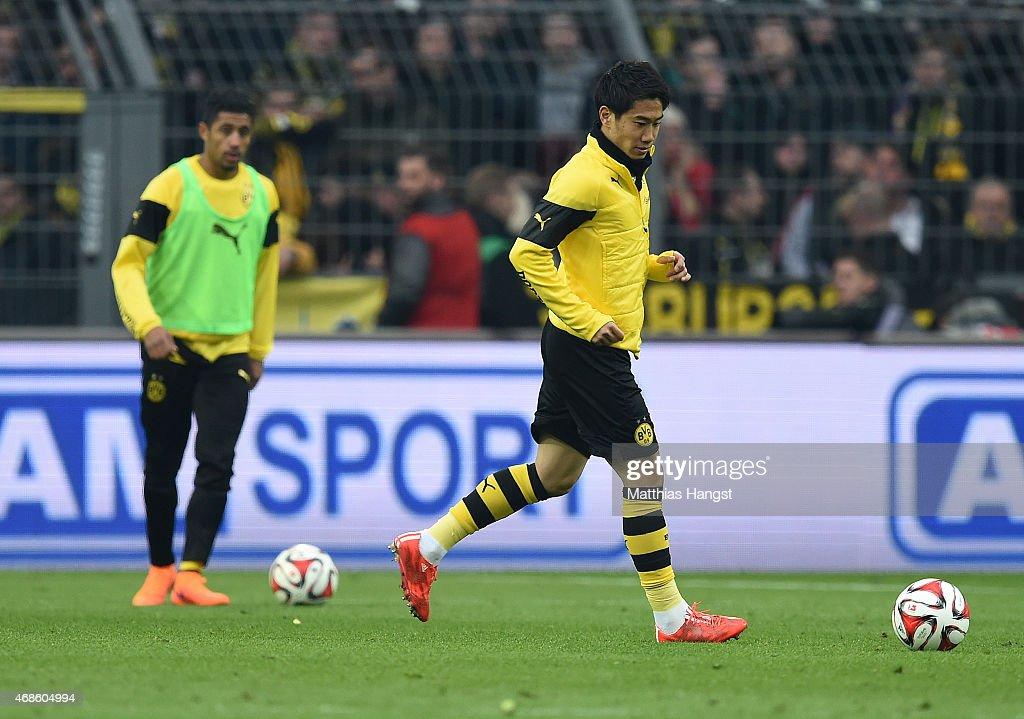 Shinji Kagawa of Dortmund warms up during halftime of the Bundesliga match between Borussia Dortmund and FC Bayern Muenchen at Signal Iduna Park on...