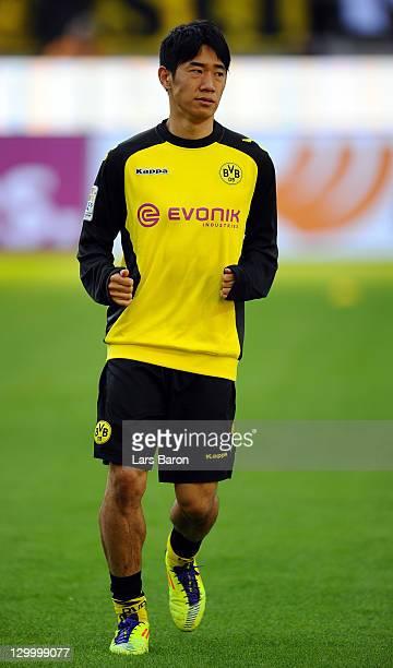 Shinji Kagawa of Dortmund warms up during the Bundesliga match between Borussia Dortmund and 1 FC Koeln at Signal Iduna Park on October 22 2011 in...