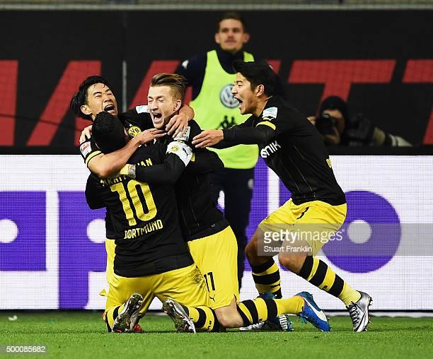 Shinji Kagawa of Dotrmund celebrates scoring the winning goal with Marco Reus of Dortmund during the Bundesliga match between VfL Wolfsburg and...