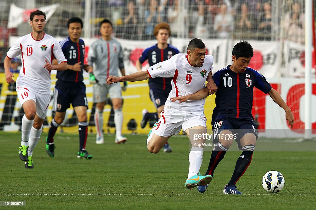 <a gi-track='captionPersonalityLinkClicked' href=/galleries/search?phrase=Shinji+Kagawa&family=editorial&specificpeople=4314029 ng-click='$event.stopPropagation()'>Shinji Kagawa</a> of Japan and Odai Alsaify of Jordan in action compete for the ball during the FIFA World Cup Asian qualifier match between Jordan and Japan at King Abdullah International Stadium on March 26, 2013 in Amman, Jordan.