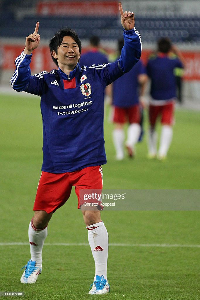 <a gi-track='captionPersonalityLinkClicked' href=/galleries/search?phrase=Shinji+Kagawa&family=editorial&specificpeople=4314029 ng-click='$event.stopPropagation()'>Shinji Kagawa</a> of Japan celebrates after the charity match between Borussia Dortmund and a Team of Japan at the Schauinsland Reisen Arena on May 17, 2011 in Duisburg, Germany. The charity match supports the earthquake victims of Japan.