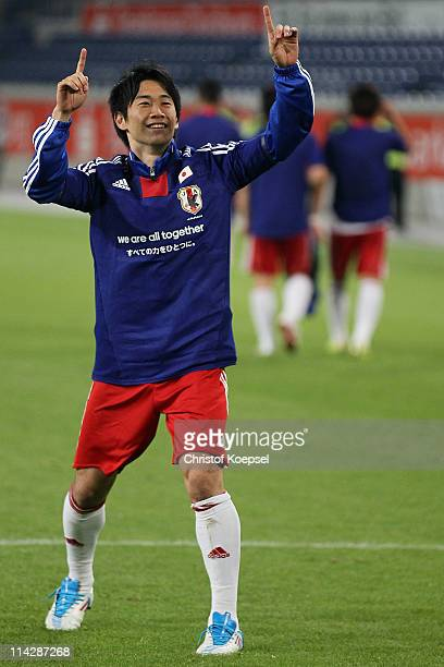 Shinji Kagawa of Japan celebrates after the charity match between Borussia Dortmund and a Team of Japan at the Schauinsland Reisen Arena on May 17...
