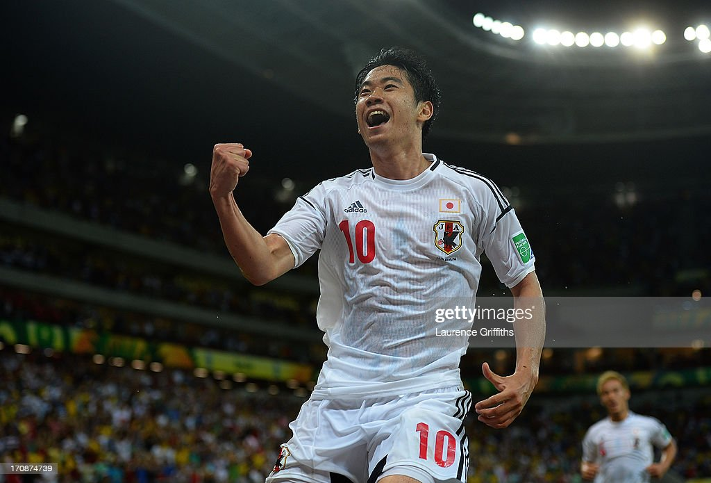 <a gi-track='captionPersonalityLinkClicked' href=/galleries/search?phrase=Shinji+Kagawa&family=editorial&specificpeople=4314029 ng-click='$event.stopPropagation()'>Shinji Kagawa</a> of Japan celebrates scoring his team's second goal during the FIFA Confederations Cup Brazil 2013 Group A match between Italy and Japan at Arena Pernambuco on June 19, 2013 in Recife, Brazil.