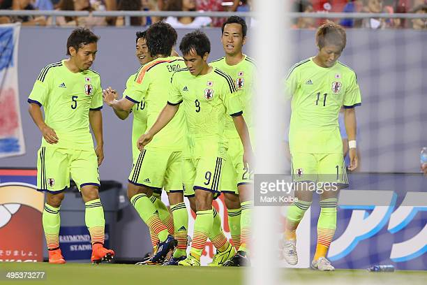 Shinji Kagawa of Japan celebrates with his team mates after scoring a goal during the International Friendly Match between Japan and Costa Rica at...