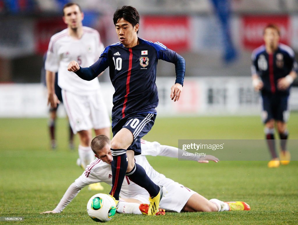 <a gi-track='captionPersonalityLinkClicked' href=/galleries/search?phrase=Shinji+Kagawa&family=editorial&specificpeople=4314029 ng-click='$event.stopPropagation()'>Shinji Kagawa</a> of Japan controls the ball during the international friendly match between Japan and Latvia at Home's Stadium Kobe on February 6, 2013 in Kobe, Japan.
