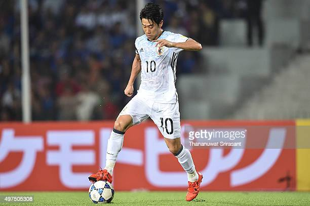 Shinji Kagawa of Japan holds the ball during the 2018 FIFA World Cup Qualifier match between Cambodia and Japan on November 17 2015 in Phnom Penh...