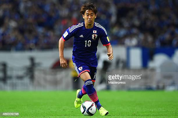 Shinji Kagawa of Japan in action during the 2018 FIFA World Cup Qualifier Round 2 Group E match between Japan and Cambodia at Saitama Stadium on...