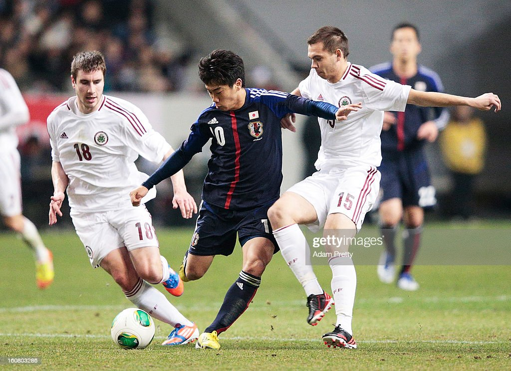 <a gi-track='captionPersonalityLinkClicked' href=/galleries/search?phrase=Shinji+Kagawa&family=editorial&specificpeople=4314029 ng-click='$event.stopPropagation()'>Shinji Kagawa</a> of Japan in action during the international friendly match between Japan and Latvia at Home's Stadium Kobe on February 6, 2013 in Kobe, Japan.