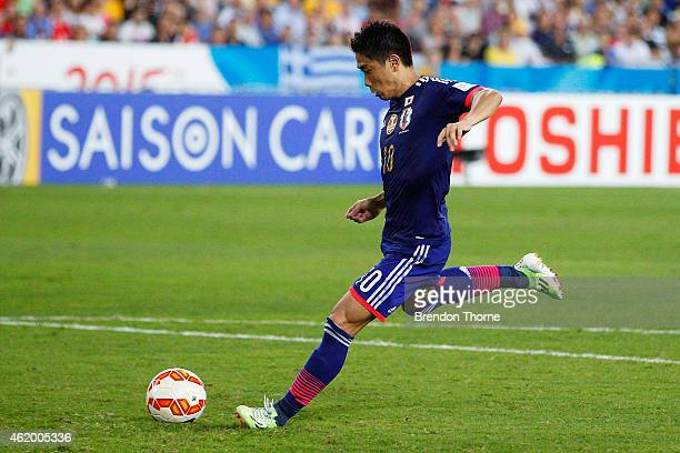 Shinji Kagawa of Japan misses a goal in the penalty shoot out during the 2015 Asian Cup Quarter Final match between Japan and the United Arab...