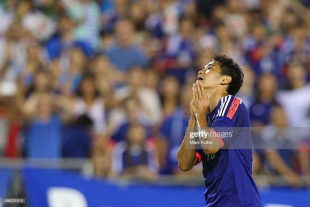 <a gi-track='captionPersonalityLinkClicked' href=/galleries/search?phrase=Shinji+Kagawa&family=editorial&specificpeople=4314029 ng-click='$event.stopPropagation()'>Shinji Kagawa</a> of Japan reacts after a missed chance during the International Friendly Match between Japan and Zambia at Raymond James Stadium on June 6, 2014 in Clearwater, Florida.